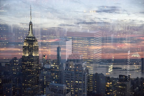 Double exposure photo of the Empire State Building and the One World Trade Center.