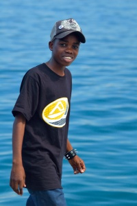 A photo of an african-american boy on a pier in Bocas del Toro, Panama.