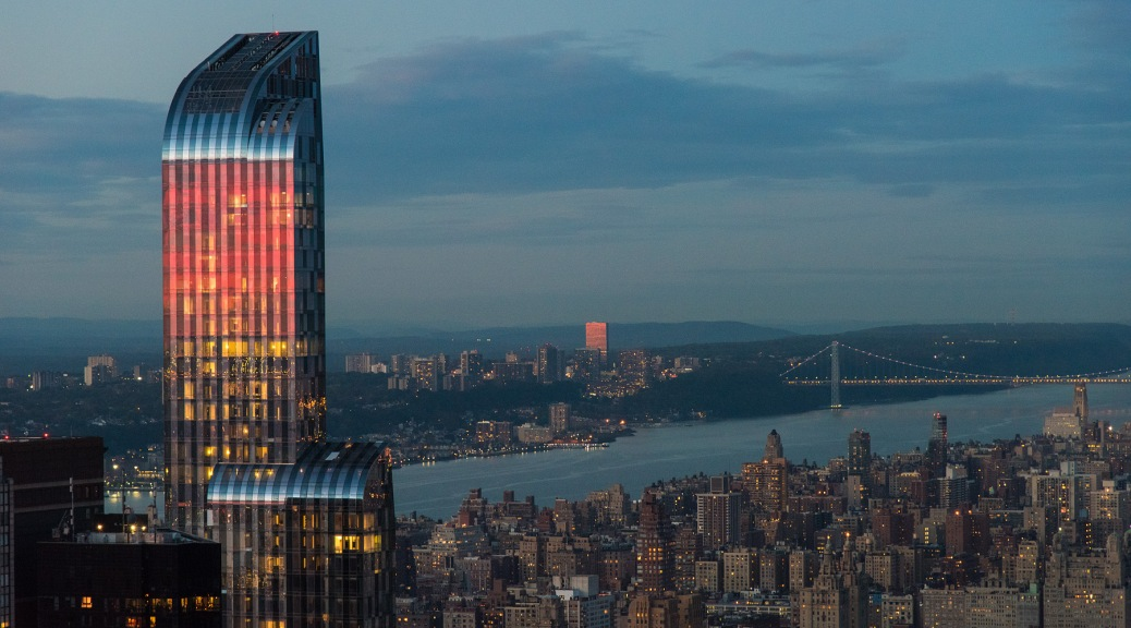 Photo of the One57 building. Red from the reflected sunset.