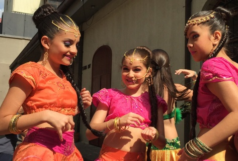 Photo of a group of Dancers backstage chatting before their show.