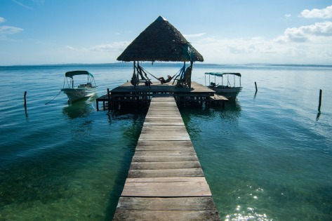 Picture of a dock and a hut showing large depth of field. Photo by Eduardo Libby