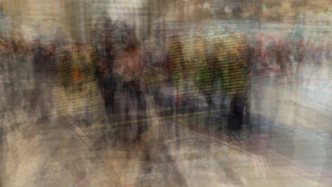 Multiple exposure of travelers and the arrrivals/departures display. Photo by Eduardo Libby.