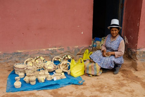 Image of a Maras, Peru woman selling baskets. Photo by Eduardo Libby