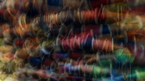 Multiple exposure image of ribbons at the Beads Shop. Photo by Eduardo Libby