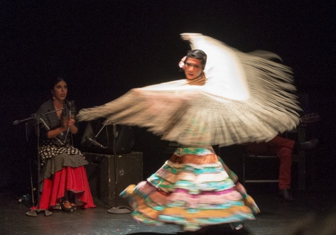 Photo of Sol Acuña spinning gracefully her Mantón.