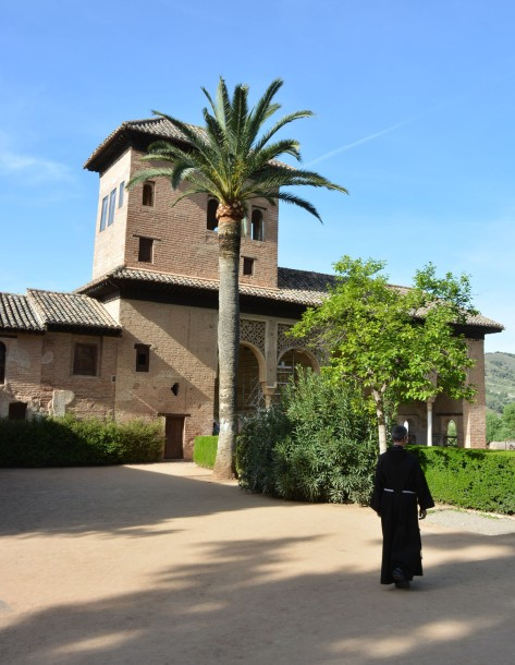 Image of a priest walking in the Alhambra. Photo by Eduardo Libby
