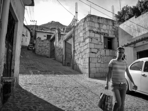 Photo of a woman on a street in Taxco. Photo by Eduardo Libby