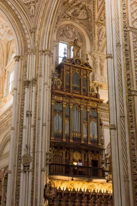 Imag of a person playing the organ at the Mosque-Cathedral of Cordoba. Photo by Eduardo Libby
