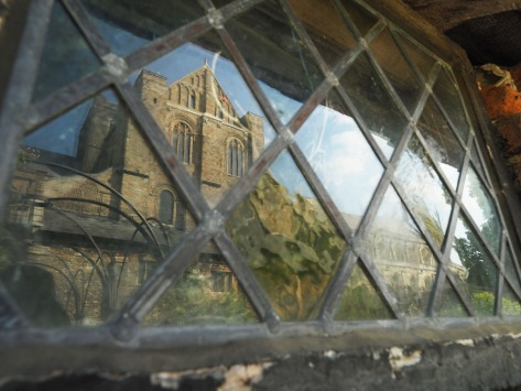 Window refelction of buildings near Winchester College. Photo by Eduardo Libby