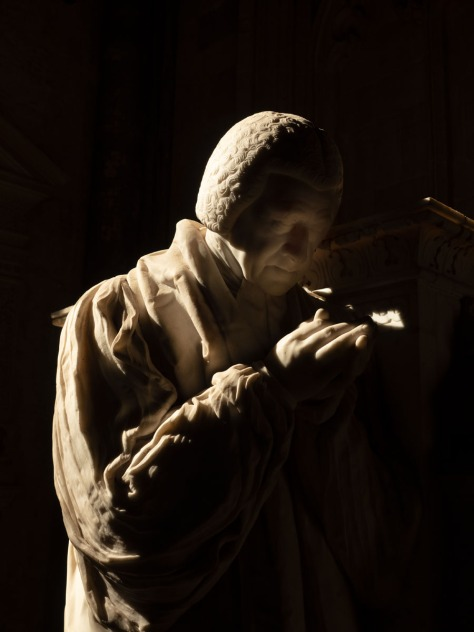 A statue inside Winchester Cathedral. Photo by Eduardo Libby