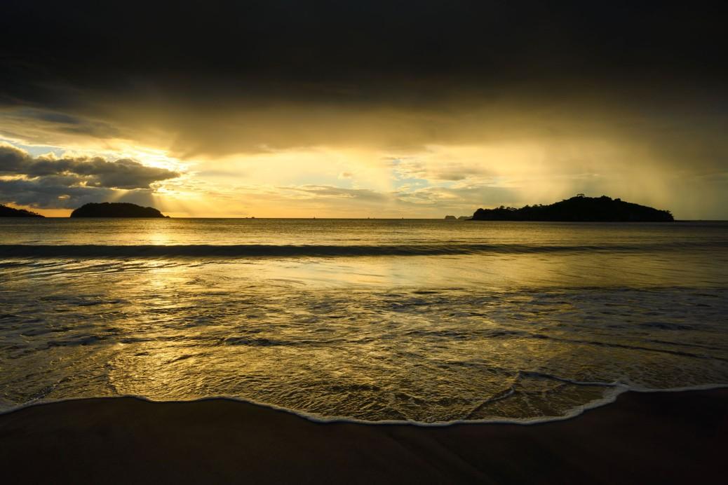 Sunset in Penca Beach, Guanacaste, Costa Rica showing distant rain. Photo by Eduardo Libby