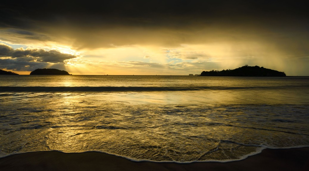 Sunset in Penca Beach, Guanacaste, Costa Rica showing distant rain. Photo by Eduardo Libby